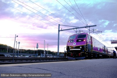 In the glow of dusk, a Boston-bound MBTA accelerates away from the station at Mansfield. The locomotive is one of the new HSP-46 diesels built by MPI at Boise, Idaho and features GE major components. Exposed with a Fujifilm X-T1 digital camera.