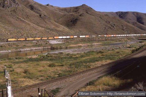 Union Pacific eastward intermodal train at Palisade Canyon, Nevada on July 24, 1993. Exposed on Kodachrome 25 with a Nikon F3T.