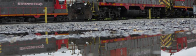 Old EMD's with puddles at Doswell, Virginia from the Tracking the Light LX7 Archive.