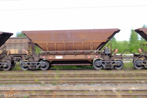 Modern high-capacity ore wagons are a contrast with the old six-wheel jennies from a century ago.