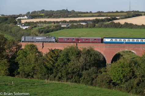 Irish Rail 087 with Emerald Isle Explorer's empty carriages at Taylorstown, County, Wexford on the South Wexford line. 28 September 2015.