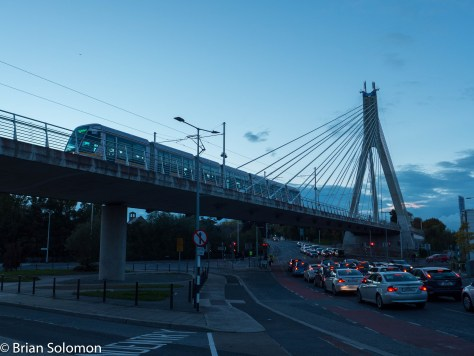 Outbound LUAS tram glides across the Dargan Bridge at Dundrum. Exposed as a RAW file with my Lumix LX7, ISO 80, white balance set to 'daylight', contrast adjusted in post processing.