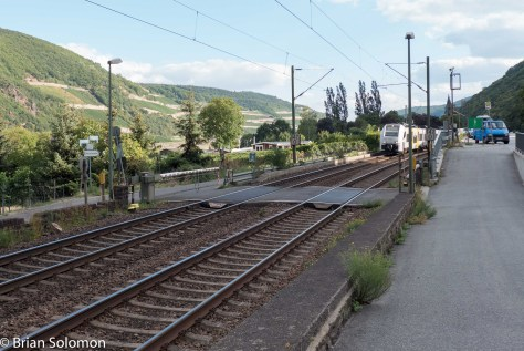 A wink of sun north of Bingen. Would this be a more interesting image if the train was closer, but bathed in shadow?