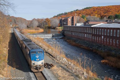 Amtrak 449 the westward Boston-section of the Lake Shore Limited passes the old mills at West Warren, Massachusetts on Halloween Day 2015.