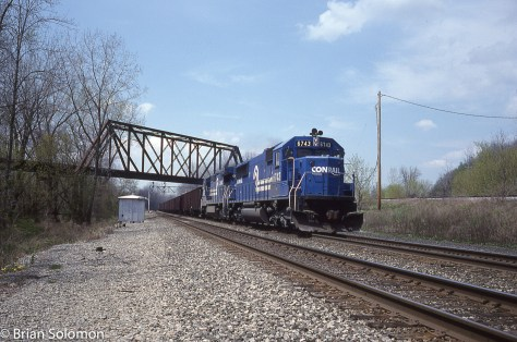 Another eastward freight with an SD50 in the lead. I wouldn't complain today about seeing three freights with Conrail blue SD50s! Back then they were pretty common, but still nice to see.