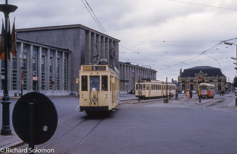 My father, Richard Jay Solomon exposed this view at Mons of SNCV trams near the railway station using a Kodak Retina 3C and Kodachrome slide film. Mons doesn't look like this any more. The trams are long gone, and place is a construction site. Back then you could also get a train across the border!