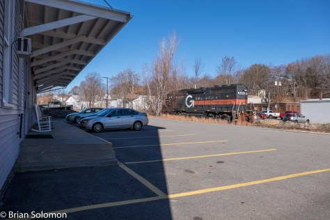 A lone GP40 eases its way down the branch passed a furniture store.