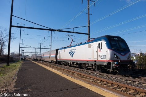 Amtrak 98 rolls eastward (northward) at Levittstown on the final leg of its trip from Florida to New York Penn-Station. Remind me, why did Amtrak invest in new baggage cars?