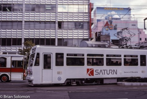 A Saturn advertisement graces a streetcar in Okayama, Japan in April 1997.