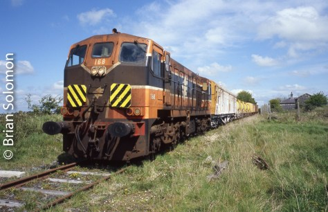 Irish Rail 168 works the weedspraying train at Ardrahan on the Athenry-Ennis line.