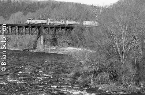 New England Central southbound 611 crosses the Millers Falls high bridge. For this image I used one of my old Canon EOS3s fitted with a 100mm Canon lens and loaded with Ilford HP5. I processed the film according to my custom tailored recipe. (See yesterday's post for details). Why Canon? Why black & white film? Because it these combinations worked for me.