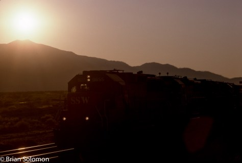 A Cotton Belt GP60 leads an eastward Southern Pacific freight over Beaumont Hill near Cabazon, California on the evening of January 29, 1994. Kodachrome 25 slide scanned with an Epson V750 Pro and processed using Lightroom.