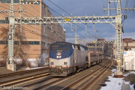 Ex-Amtrak P40 (DASH8-40BP) 834 leads westbound Shore Line East train 1169 (deadhead) under wire at West Haven on Metro-North's former New Haven Railroad mainline at 3:53 pm on January 29, 2016.