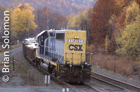 CSX GP40-2 6214 leads a local freight at Middlefield, Massachusetts in October 2001.