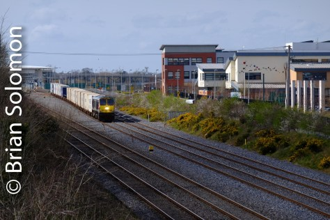 The IWT Liner approaches. You can see Adamstown Station in the distance in full sun. A muddy black shadow mucks up the foreground.