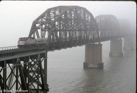 Amtrak_Capitols_crossing_Suisun Bay Bridge_Martinez_CA_Feb1992_Fujichrome_Brian_Solomon_575116