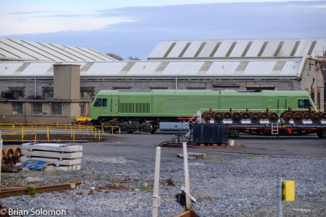 One of kind livery; Irish Rail 216 in a green primer at Inchicore as seen from the train.