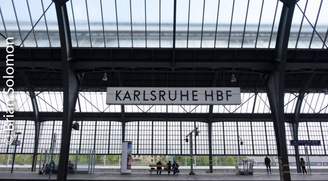 Karlsruhe Hbf—Train Shed Geometry and Red Electrics.