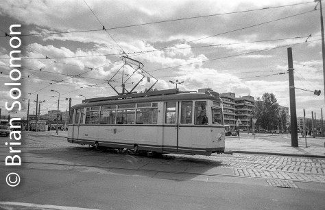 A preserved four-wheel tram grinds along in Dresden on 30 April 2002. I exposed this image using a Contax G2 with 28mm Biogon lens on Ilford HP5 black & white negative film. I used a deep red filter to adjust contrast. The other day I scanned it using an Epson V600 and then adjusted the file using Lightroom to tweak shadow detail and eliminate dust specs.