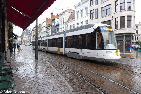 A modern Flexity2 tram glides through the rain in Antwerp. Lumix LX7 photo.