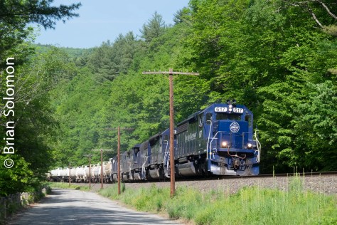 Once a week Pan Am runs a unit clay slurry train from the connection with Vermont Rail System at North Bennington/Hoosick Falls to Maine. This often runs with Pan Am locomotives.