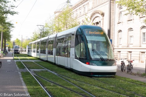 Among my first fews of the Strasbourg tram system. Notice the rail-mounted cleaning truck in the distance.