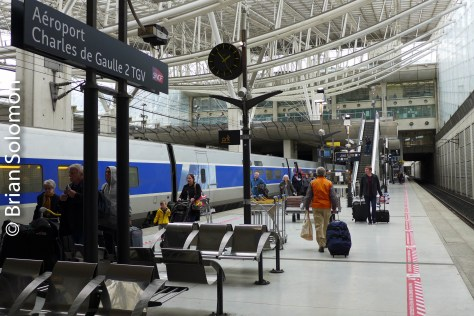 TGV pauses at Charles de Gaulle airport. Take the plane to the train! It works, just ask Pop.