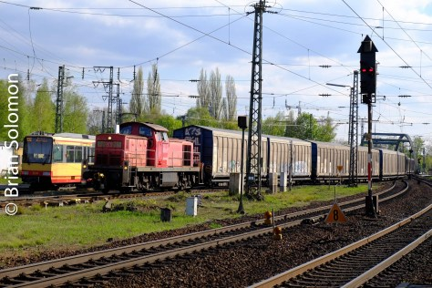A diesel leads a local freight from a nearby automotive factory.