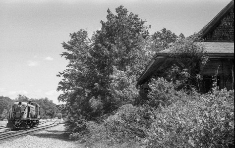 Batten kill's old RS-3 chortles its way up the interchange tracks. On the right is the old Boston & Maine station at Eagle Bridge, New York. Exposed on Ilford HP5 using a Leica 3A with Nikkor 35mm lens. Film processed using a two bath HC110 developer mix in a Jobo processing machine.