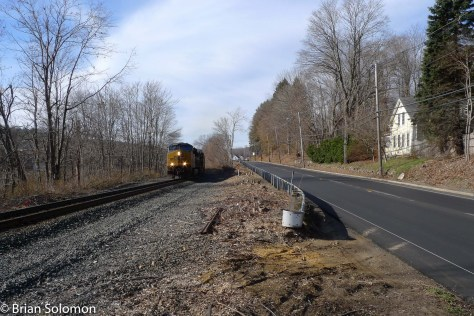 CSX Q264 (carrying auto racks for delivery in East Brookfield, Massachusetts). Exposed using a Lumix LX3 with Leica Vario-Summicron lens.