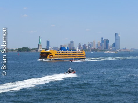 Staten Island Ferry with famous lady holding torch in background.