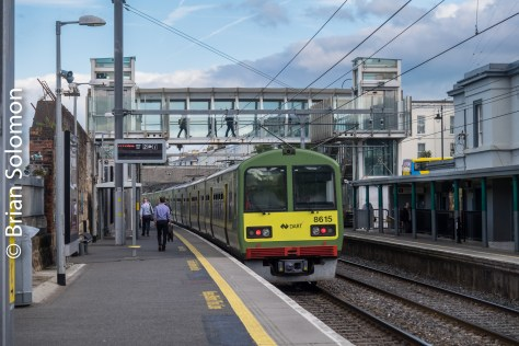 My train accelerates away from the platform at Blackrock. The modern footbridge makes for a dominant visual element, but also offers a photo platform.