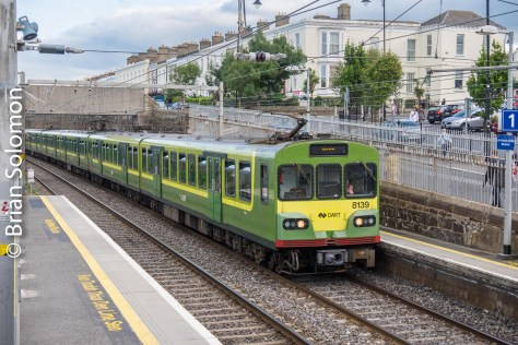 A Dublin bound German-built DART train approaches Blackrock. I aimed to feature the terrace houses above the line while minimizing the visually obnoxious elements of catenary and graffiti covered seawalls.