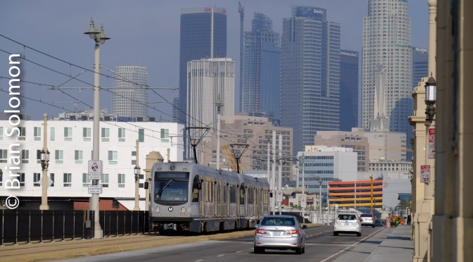 Gold Line with Skyline—Los Angeles Metro Rail.