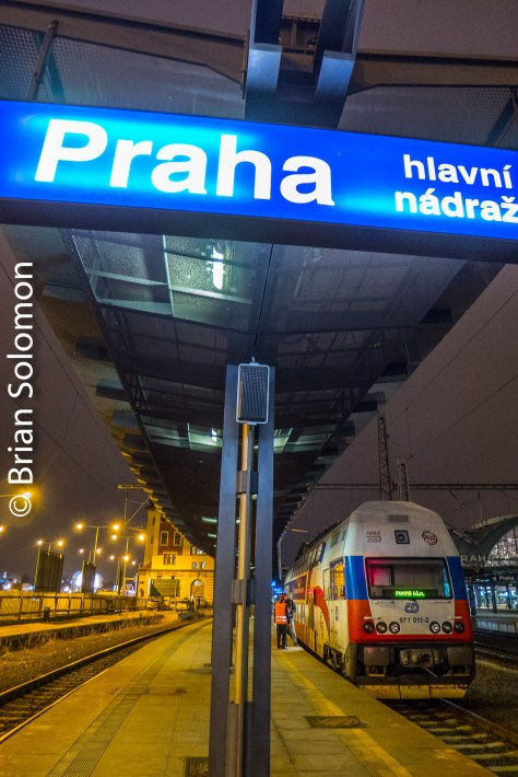 A double-deck suburban electric multiple unit decorated to commemorate an anniversary of Czech Railways basks in the evening glow at the south end of Prague's Main Station. Lumix LX7 photo.
