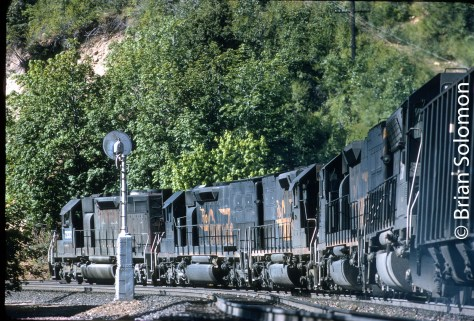 On July 19, 1992, Southern Pacific's SNTA-C descends the west slope of Donner Pass near Midas, California.