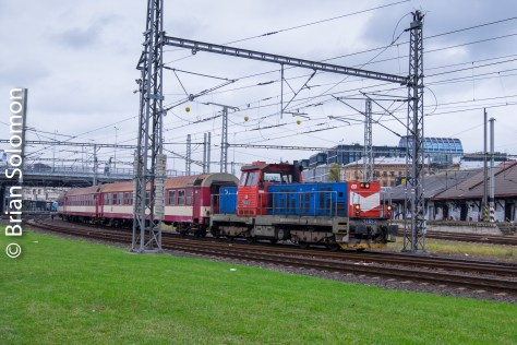 A diesel hauled train departs Prague Masarykovo Nadrazi, FujiFilm X-T1 photo.