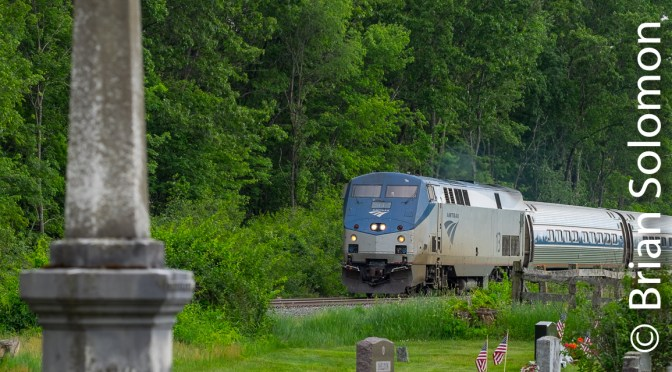 Amtrak's Vermonter with American Flags.