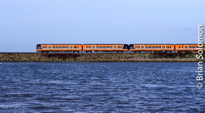 Lessons of Time: Orange Railcars on the Causeway—Donabate, March 2000.