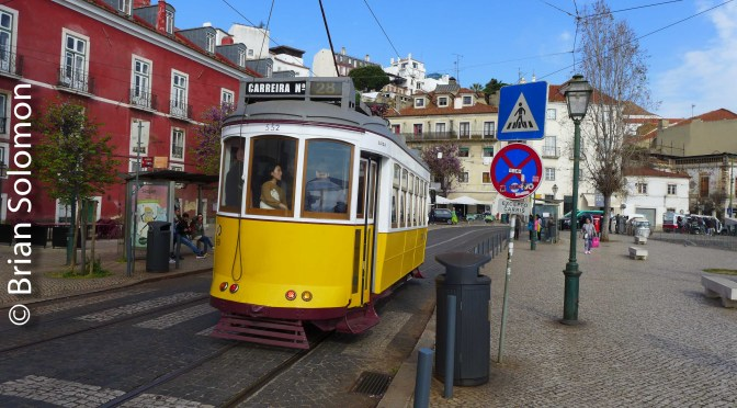 Lisbon Historic Tram—Something Missing? (Two photos).