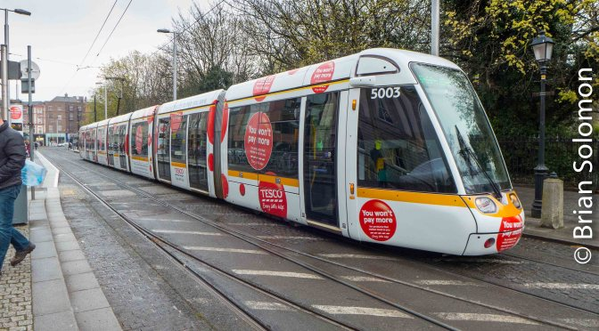 TESCO Tram Prowls Dublin Streets.