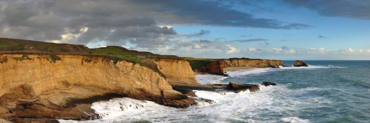 A panoramic image of the cliffs and ocean looking south along the coast between Davenport and Santa Cruz, California.