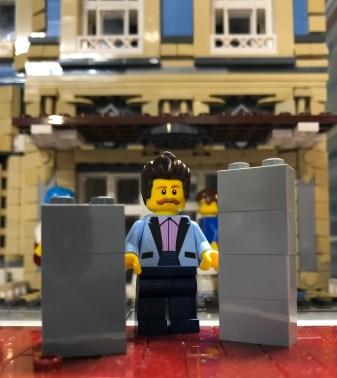 Tom Brcikorti next to LEGO bricks.
