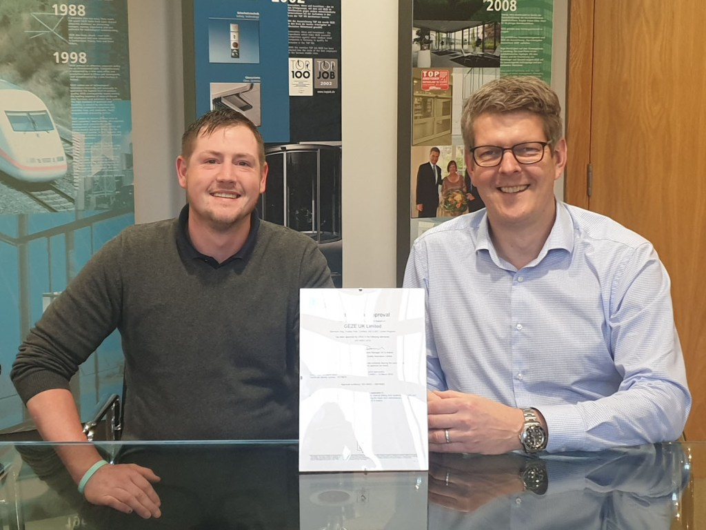 Gavin Downes HSQE Manager at GEZE UK (left) with GEZE UK managing director Kaz Spiewakowski, with the certificate.
