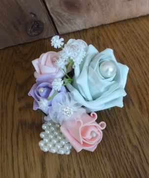 Blue and pink wrist corsages