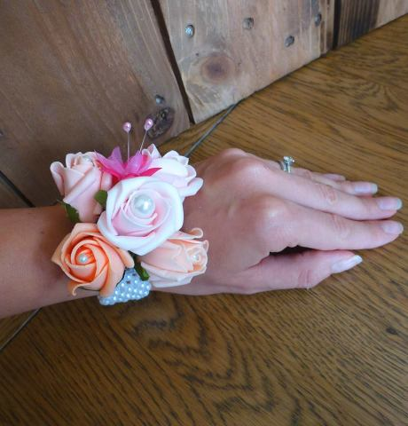 Pink and coral pearl wrist corsage roses