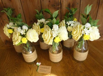 Rustic hesian lemon yellow milk bottles table decoration