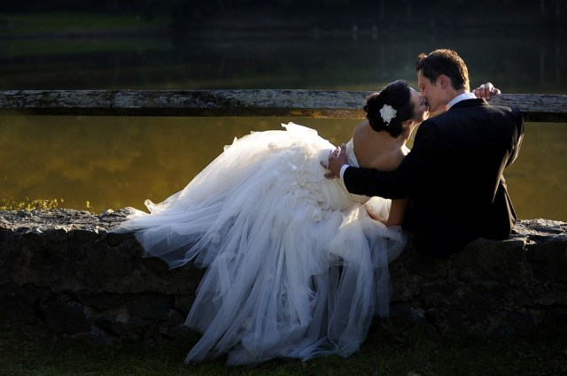 bride kiss near lake