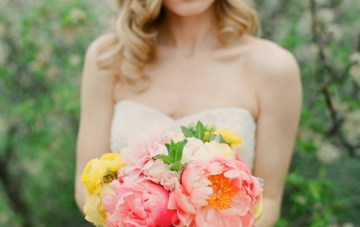 Bride with pink and yellow bouquet   Laura Murray Photography