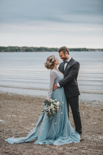 Stormy Scandinavian Wedding Inspiration Featuring a Dramatic Blue Gown | Snowflake Photo 23